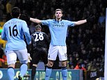 Star of the show: Edin Dzeko scored within two minutes for Manchester City