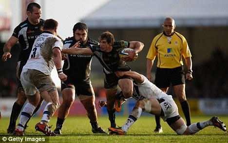 Argie-bargy: Exeter's Argentine international wing Gonzalo Camacho hands off a challenge from Bath and England prop David Wilson