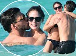 Time to get a room! Olivia Palermo and boyfriend Johannes Huebl go heavy on the PDA... as they frolic in the surf of St. Barts