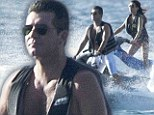 Captain Cowell rides again! Simon shows his skill on a jet ski as his maritime holiday adventure continues