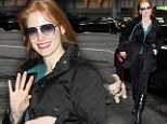 Leading lady! Jessica Chastain takes dog for a walk outside theatre before Broadway performance of The Heiress
