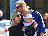 Melt your heart: Chris Hemsworth was spotted being the perfect husband and dad with his wife Elsa Pataky and baby daughter India Rose while out for a walk in Palm Springs, California, on Thursday
