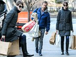 She still loves a bargain! Millionaire Anne Hathaway shops up a storm in the sale with husband Adam Shulman
