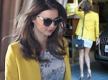 If you've got it... flaunt it! Miranda Kerr shows makes her legs look even longer by slipping on nude heels