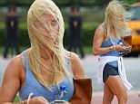 Jill Martin was more than a little annoyed after suffering an enforced bad hair day after being caught by a sudden gust of wind in Miami on Friday