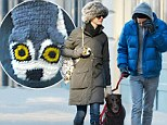 With an energetic dog in the household Anne Hathaway and husband Adam Shulman had no choice but to pull on their warmest clothes and head outside.