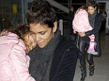 Back in her mother's arms! Halle Berry scoops up daughter Nahla after Parisian holiday with Olivier Martinez