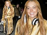 Making an entrance: Lindsay Lohan dons dramatic full length fur coat to travel to London... where she'll 'pursue Max George'