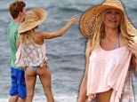 Pamela Anderson shows off curves in lace bikini during Hawaiin beach...but who's the red haired mystery man?