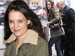 Best foot forward! Katie Holmes puts on brave face in New York downpour... with play's end only a week away