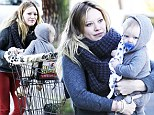 Hilary Duff dons red skinny jeans to grab coffee and groceries with baby Luca