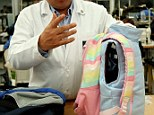 Pint-size: Miguel Caballero shows off his company's newest addition - child-size bulletproof clothing