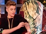 Tat-aboy! Justin Bieber shows off his new rose tattoo on internet