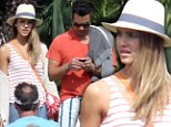 Soaking it up! Jessica Alba loves the heat but keeps hat on... in Mexico with husband Cash Warren and daughters