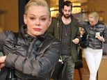 Heading out for a shopping ski: Rose McGowan looks ready to hit the slopes as she indulges in a spot of retail therapy