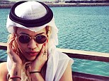 Sultry: Rota protects her hair from the sun in a headdress known traditionally as a keffiyeh or kufiya
