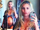 Where's that been hiding? Jessica Simpson shows off her large baby bump in a bikini