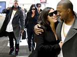 Pregnant Kim Kardashian and Kanye are in for a bumpy ride as they are pictured for first time since baby news at the airport