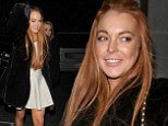 Can she afford that? Lindsay Lohan stays warm in yet another fur coat... while out to dinner in London