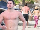 Channing Tatum and Wife Jenna Dewan relax on a beach in St Barts.