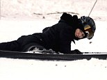 Face plant: Madonna was seen lying face down in the snow with her legs splayed out after falling over during a ski session in Gstaad, Switzerland