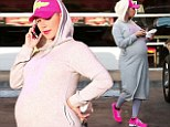 Ready to pop! Heavily pregnant Amber Rose treats herself to pizza as she awaits the arrival of her son