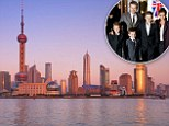 New home? The Beckhams could be moving to China so David can play for Shanghai Shenhua