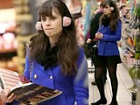 Cake queen! Zooey Deschanel shops for baking ingredients for NYE...with the help of her giant cook book