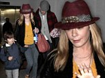 'Home sweet home!' LeAnn Rimes arrives back to Los Angeles with Eddie Cibrian and his boys