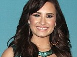 Back to her best: Demi Lovato on the red carpet for The X Factor finale in Los Angeles last week