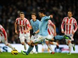 Spot on: Sergio Aguero competently puts his penalty in to make it 3-0