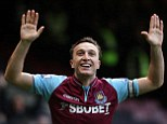 Hands up! Mark Noble celebrates after putting West Ham a goal up from the penalty spot after only three minutes