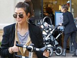 Kourtney Kardashian and her boyfriend Scott Disick were spotted puzzling over how to build the luxury pushchair as they stood outside their vehicle in Beverly Hills on Sunday.