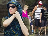 Liv Tyler uses scarf as shield from rain during Hawaiian lava hike with dad Steve and son Milo