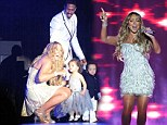 Mariah Carey brought husband Nick cannon and their two children up on stage during a New Year's Day concert in Australia on Tuesday