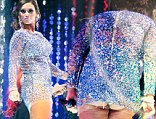 The thigh really IS the limit! JWoww suffers wardrobe malfunction when her dress hitches up to flash too much flesh at New Year's bash