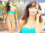 Sizzling! Karina Smirnoff takes in the rays in blue print bikini... one day ahead of NYE hosting gig in Miami
