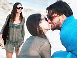 The amorous couple were busy hugging and kissing as they embraced on the beach during their sunshine vacation on Sunday.