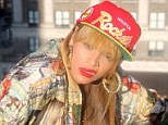 Beyoncé shows she's got swagger as she goes retro for New Year in snap-back cap and large hooped earring