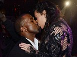 Toasting the New Year: Kim Kardashian kisses boyfriend Kanye West as the clock chimes midnight, the same day that she announced her pregnancy to the world