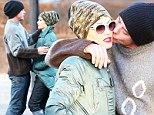 The love treatment! Gwen Stefani gets kiss and a hug from husband Gavin Rossdale... at London park with son Zuma
