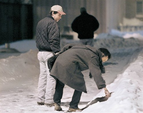 Noriaki Takada writes his phone number in the snow in ...