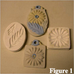 Modern sprig molding were created by prssing clay into small molds as shown here - click on image to see a larger view.