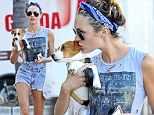 Heavy metal babe! Candice Swanepoel rocks out Iron Maiden T-shirt and displays her trim pins in Daisy Dukes as she kisses her cute dog