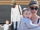 Look who's walking now! January Jones keeps her son close... as they step out for lunch in matching grey jumpers and jeans