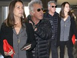 More in love than ever! Married couple of 32 years Dustin Hoffman and wife Lisa dote over one another at LAX