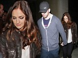 Playing footsy: Hot Hollywood couple Minka Kelly and Chris Evans go clubbing at LA's super trendy Bootsy Bellows