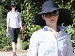 Sun hat: Anne Hathaway always makes sure she is protected against the sun
