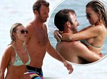 Well, you said you didn't want to date a hockey player! Wayne Gretzky's wildchild daughter Paulina confirms romance with golfer Dustin Johnson on Hawaiian holiday