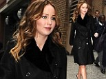 Stylish in the city! Jennifer Lawrence stops traffic in New York... in a red dress and chic black trench coat